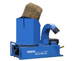 Blue machine for blowing hay for landscaping